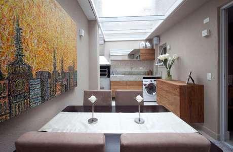 39. Área gourmet com lavanderia e armários planejados – Foto ìnterest