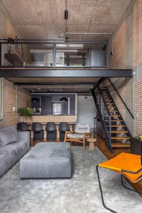 2. Loft estilo industrial com cama no mezanino. Fonte: Muito Chique