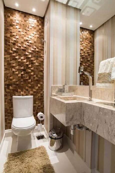 7. Banheiro social decorado com revestimento 3D – Foto: Homify
