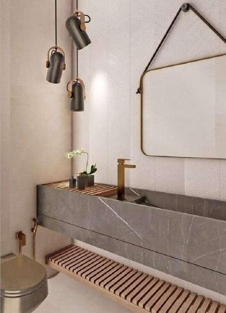 35. Decoração moderna para banheiro social com bancada planejada cinza – Foto: Archtrends