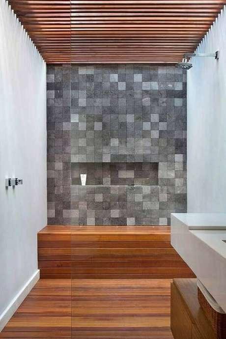 65. A pedra de revestimento miracema decora a área do banho. Fonte: Pinterest