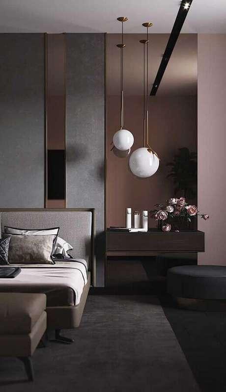11. Puff preto para quarto de casal moderno com decoração sofisticada – Foto: Behance
