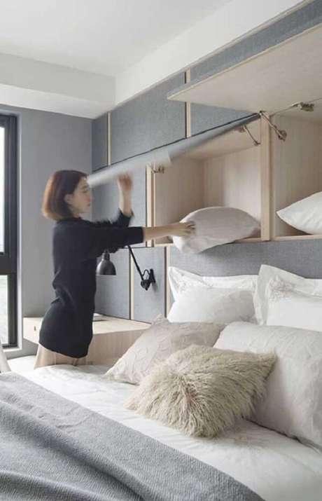 7. Aproveite todos os espaços do dormitório e invista no armário basculante. Fonte: Pinterest
