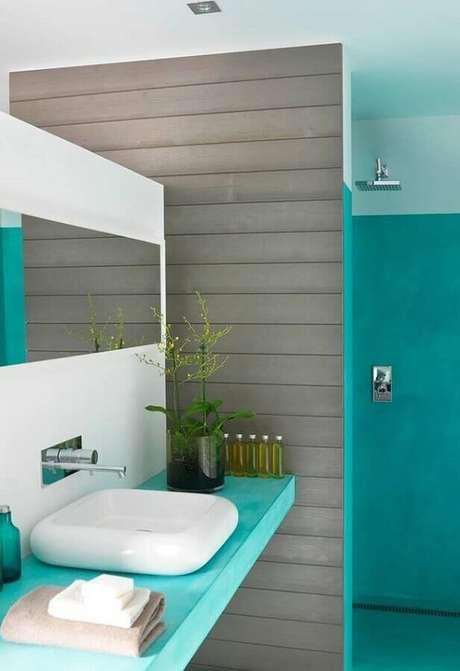 35. Decoração moderna para banheiro azul turquesa e cinza – Foto: Histórias de Casa