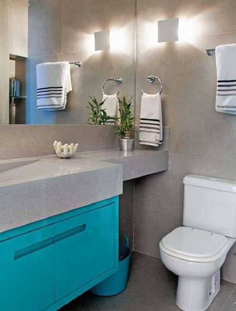 4. Decoração moderna com parede de cimento queimado para banheiro azul turquesa e cinza – Foto: Ricardo Mello & Rodrigo Passos