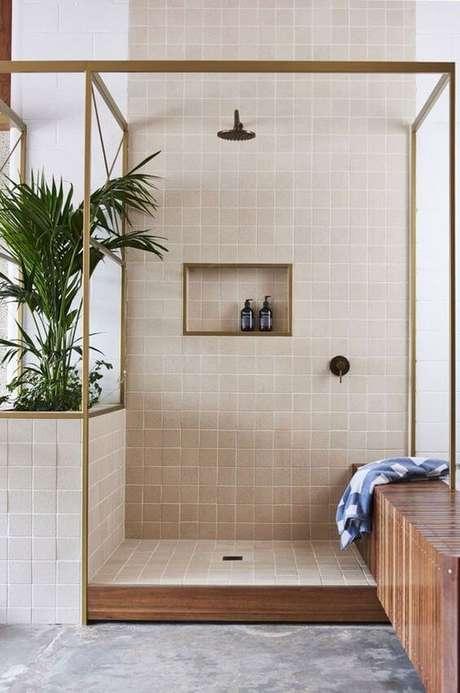 47. Banheiro com revestimento bege na sala de estar – Foto Casa Vogue