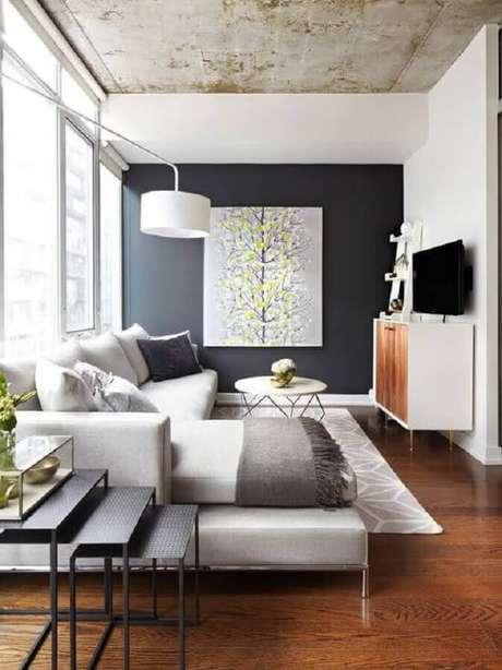 23. Decoração de sala com parede preta e mesa de centro redonda aramada – Foto: Pinterest
