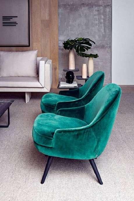 40. Conjunto de poltrona pé palito verde para sala de estar. Fonte: VejaSP