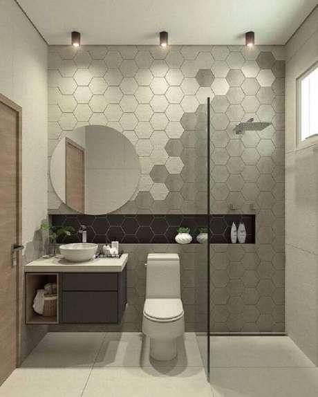 27. Decoração de banheiro moderno com revestimento hexagonal cinza em várias tonalidades – Foto: Arkpad