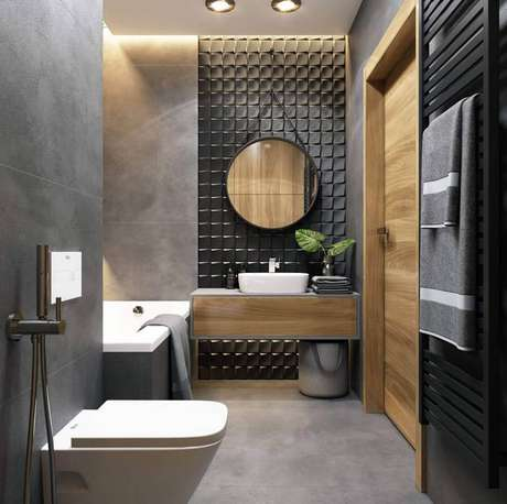 50. Revestimento cinza para banheiro moderno decorado com gabinete de madeira suspenso – Foto: JolyGram