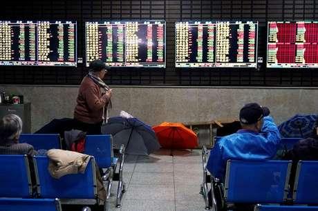 Corretora em Xangai. REUTERS/Aly Song