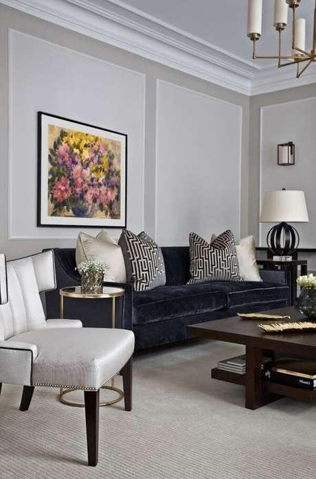 34. Sala com sofá em l azul marinho – Foto Pinterest