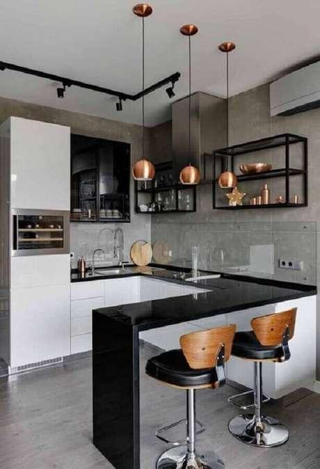 15. Decoração estilo industrial para cozinha planejada com balcão em U – Foto: Pinterest