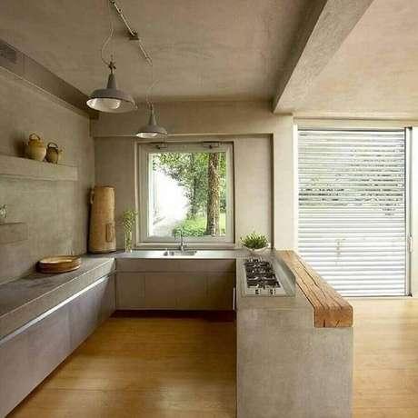 11. Decoração de cozinha com balcão de concreto e madeira – Foto: Pinterest