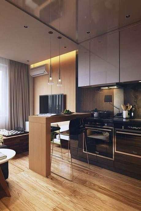 50. Decoração moderna para cozinha com balcão de madeira – Foto: Behance