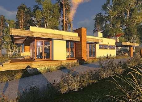 12. A fachada da casa de fazenda ficou muito moderna mesclando paredes de vidro com detalhes em madeira