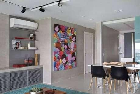 38. Quadro grande para decoração de sala de jantar integrada com sala de estar – Foto: Fernanda Azevedo Mancini