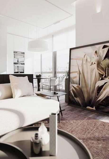11. Decoração moderna para sala de estar com quadro grande apoiado no chão – Foto: Architecture Art Designs