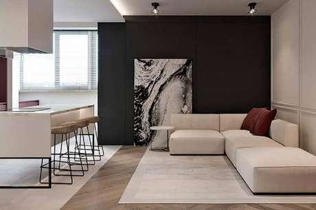 21. Decoração minimalista com quadro grande para sala de estar integrada com a cozinha – Foto: Pinterest