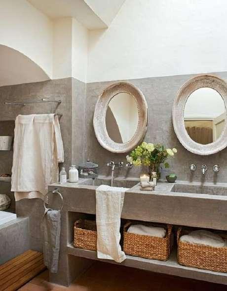 7. A bancada de cimento queimado desse banheiro é o ponto alto da decoração. Fonte: Homify