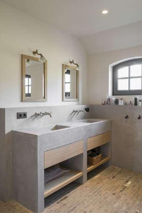 26. Bancada de banheiro de cimento queimado para ambiente compartilhado. Fonte: Pinterest