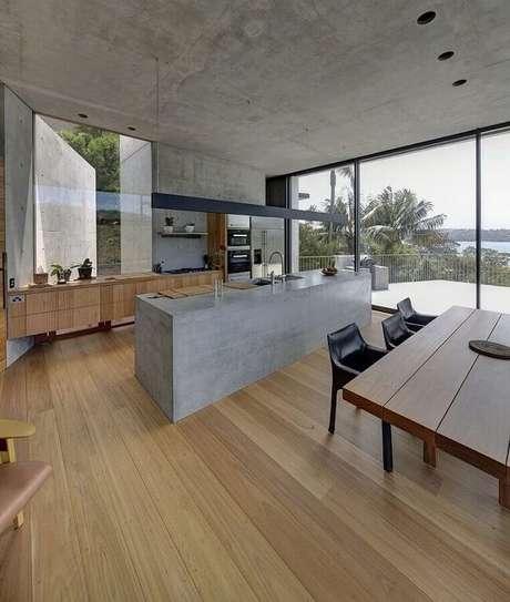 9. A bancada de cimento queimado é moderna e combina com vários estilos de decoração. Fonte: Bella Vie Interiors