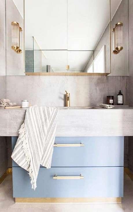 11. A bancada de cimento queimado e cuba juntas otimizam os espaços do banheiro. Fonte: Pinterest