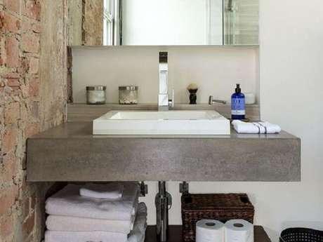39. Decoração simples com bancada de banheiro de cimento queimado. Fonte: Content Architecture