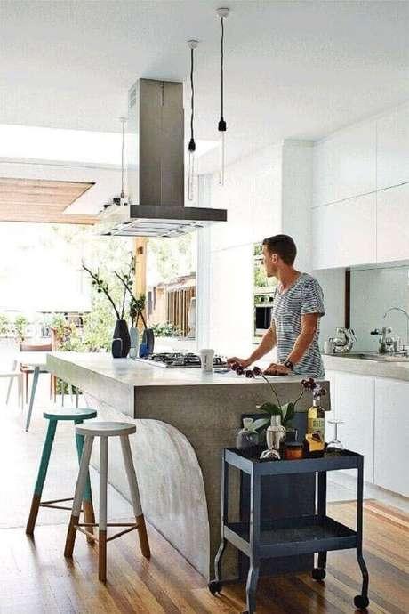 3. Design dessa bancada de cimento queimado chama a atenção na decoração. Fonte: Pinterest