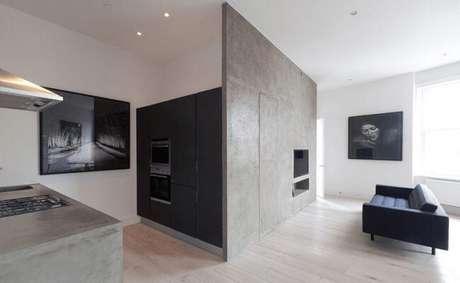 19. Ambiente compartilhado com bancada de cimento queimado na cozinha. Fonte: Temple Blake