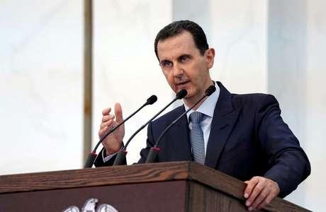 Assad em discurso a novos membros do Parlamento sírio em Damasco  12/8/2020 SANA/Handout via REUTERS