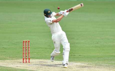 Um jogador de críquete durante uma partida entre Austrália e Índia