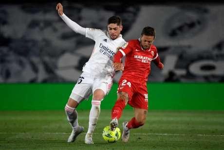 Real Madrid tropeçou diante do Sevilla na última rodada (Foto: PIERRE-PHILIPPE MARCOU / AFP)