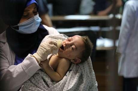 O pai do bebê não estava em casa no momento do ataque. 'Só tinha mulheres e crianças', disse ele.