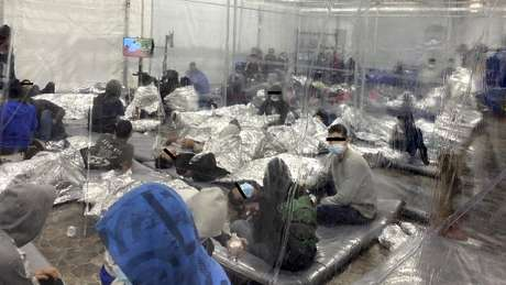 Migrants at the US Customs and Border Protection temporary processing centre in Donna, Texas, 22 March 2021