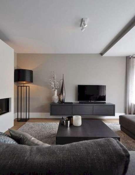 37. Decoração com abajur de pé para sala de estar cinza moderna – Foto: Futurist Architecture