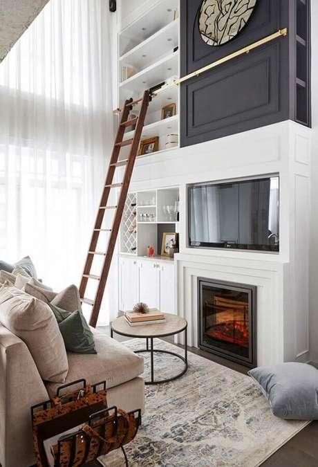 56. Sofá sem braço para decoração de sala de estar com lareira – Foto: Apartment Therapy