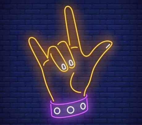 O famoso gesto dos rockeiros - Shutterstock