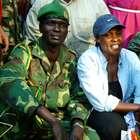 A mulher que se aproximou de líder de milícia sanguinária