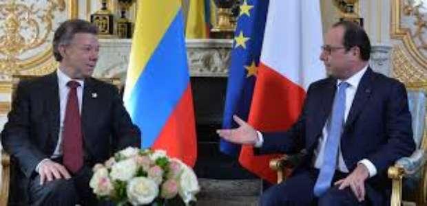 Santos recibe a Hollande con honores militares en el ...