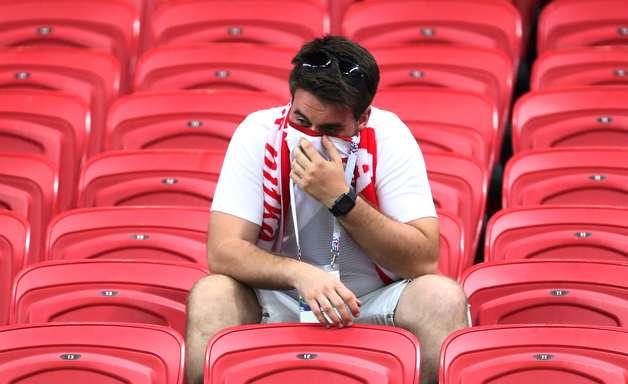Alegria e tristeza: veja os torcedores de Polônia x Colômbia