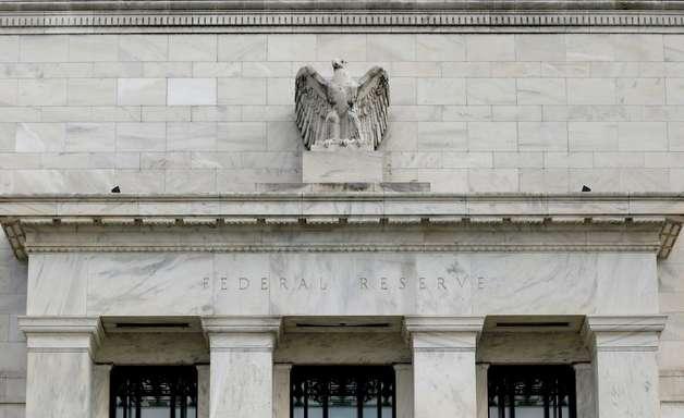Fed sinaliza redução de compra de títulos em breve e alta de juros em 2022