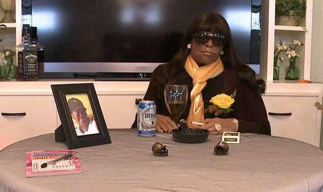 <p>Retrato de um jogador da equipe de futebol americano de New Orleans foi colocado na mesa, que continha as maiores paixões da mulher morta</p>