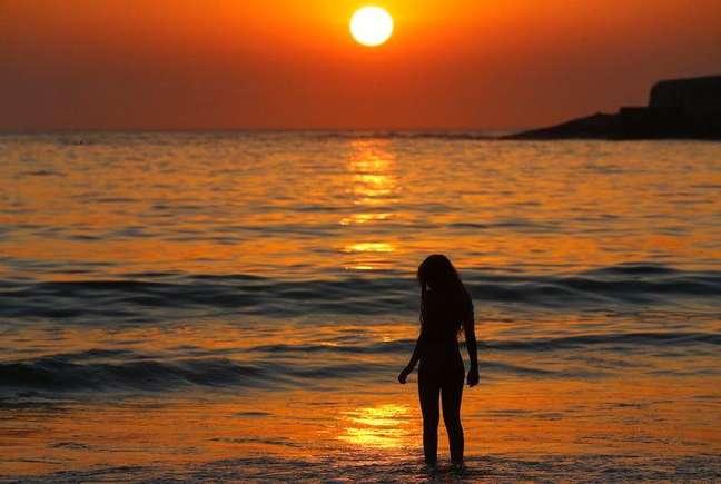 <p>Mulher na praia de Copacabana</p>