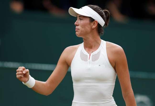 A tenista Garbine Muguruza comemora a conquista do título de Wimbledon