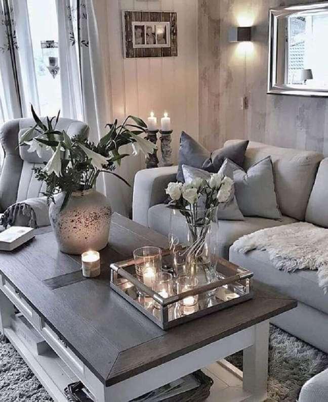 40. Decoração de sala clean com tons de cinza cinza