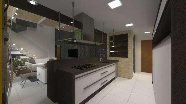50. Cozinha planejada preta com coifa sobre a ilha