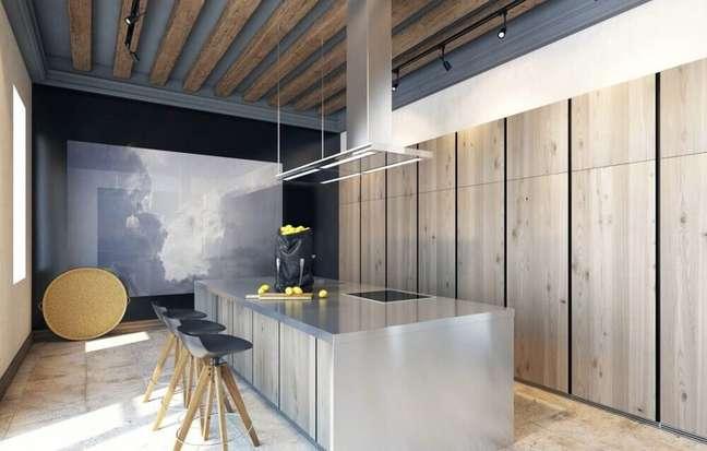 43. A cozinha com coifa de vidro fica muito moderna