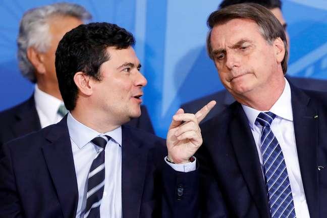 Presidente Jair Bolsonaro e ministro Sergio Moro durante cerimônia no Palácio do Planalto 29/08/2019 REUTERS/Adriano Machado