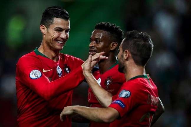 Cristiano Ronaldo e Bernardo Silva marcaram para Portugal (Foto: AFP)